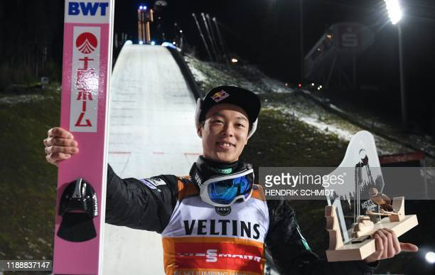 Japan's Ryoyu Kobayashi poses with the trophy after he won the men's Ski Jumping World Cup event in the Vogtland Arena in Klingenthal, eastern...