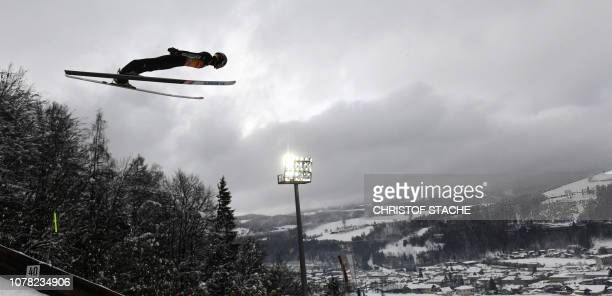 Japan's Ryoyu Kobayashi soars through the air at the fourth stage of the FourHills Ski Jumping tournament in Bischofshofen Austria on January 6 2019