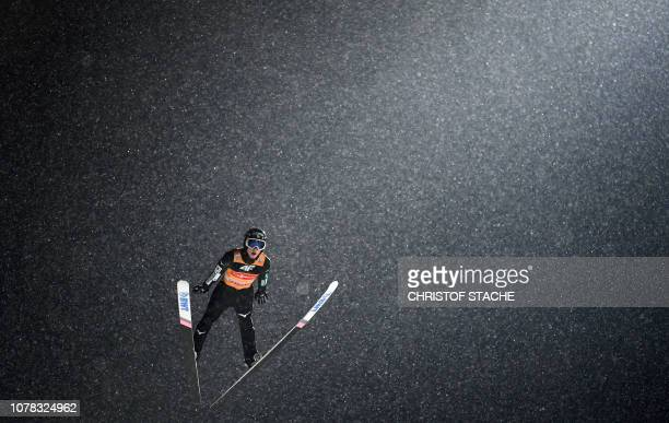 Japan's Ryoyu Kobayashi soars through the air during his first competition jump at the fourth stage of the FourHills Ski Jumping tournament in...