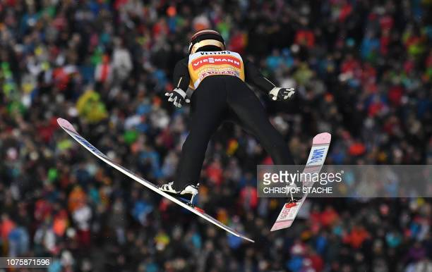 Japan's Ryoyu Kobayashi soars through the air during his trial jump at the first stage of the FourHills Ski Jumping tournament in Oberstdorf southern...