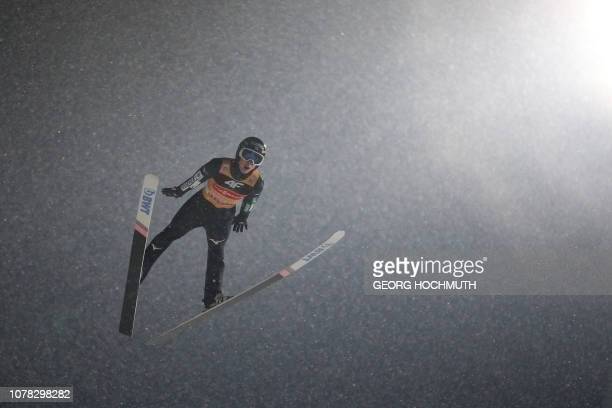 Japan's Ryoyu Kobayashi soars through the air during the fourth stage of the FourHills Ski Jumping tournament in Bischofshofen Austria on January 6...