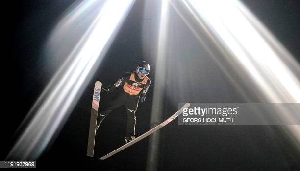 Japan's Ryoyu Kobayashi soars through the air during the qualification jump at the fourth stage of the Four Hills Ski Jumping tournament in...