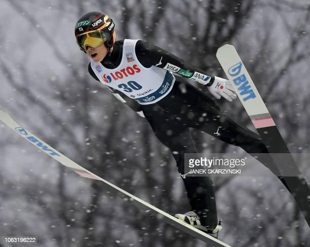 Japan's Ryoyu Kobayashi soars through the air during the the FIS Ski Jumping World Cup in Wisla Poland on November 18 2018 Russia's Evgeniy Klimov...