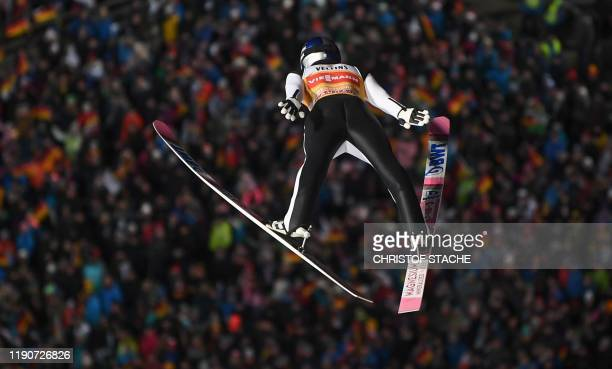 Japan's Ryoyu Kobayashi soars through the air in front of spectators during his first competition jump of the FourHills Ski Jumping tournament on...