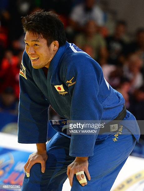 Japans Ryunosuke Haga celebrates after defeating Germanys KarlRichard Frey to win the mens gold medal match in the 100kg category at the Judo World...