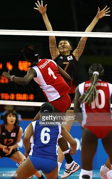 Japan's Sachiko Sugiyama tries to block a smash from Venezuela's Yessica Paz in a women's volleyball preliminary match of the Beijing 2008 Olympic...