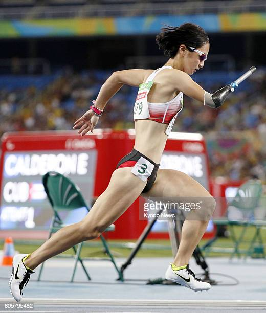 Japan's Sae Tsuji competes during the women's 400meter T4547 class for athletes with single or double full or partial arm amputations impaired muscle...