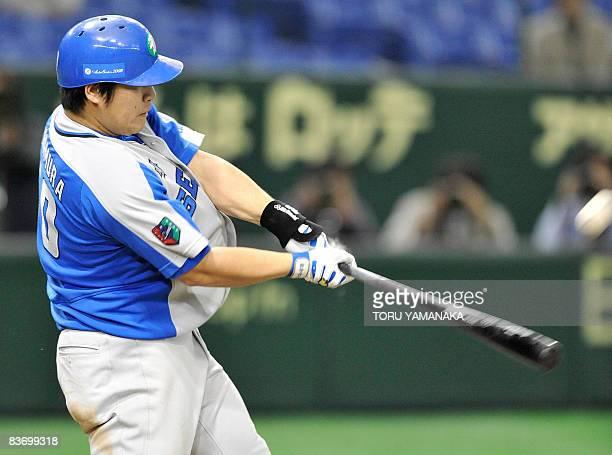 Japan's Saitama Seibu Lions slugger Takeya Nakamura hits the ball to a threerun homer during the second inning of the Asia Series 2008 baseball game...