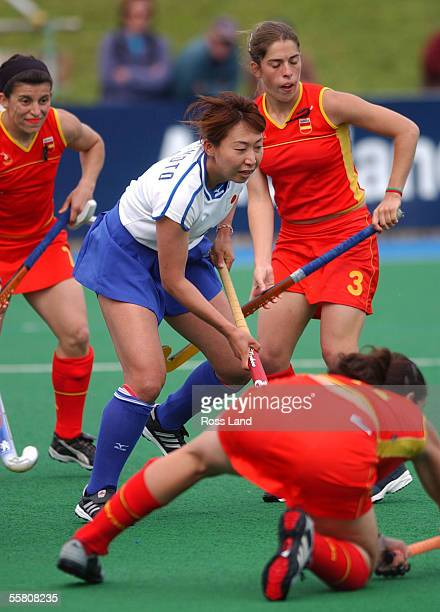 Japans' Sakae Morimoto works her way through the Spanish defence of Ma Carmen Martin Rocio Ybarra and Marta Prat during japans' 10 win over Spain in...