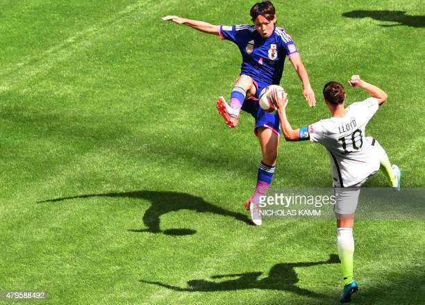 Japan's Saki Kumagai and USA's Carli Lloyd vie for the ball during the 2015 FIFA Women's World Cup final between the USA and Japan at BC Place...