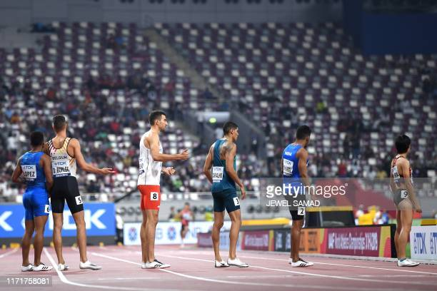 Japan's Saki Takashima waits to receive the baton in the Mixed 4 x 400m Relay heats at the 2019 IAAF World Athletics Championships at the Khalifa...