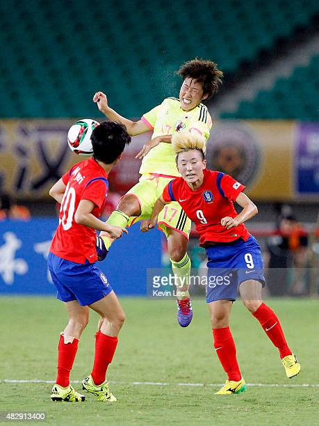 Japan's Saori Arimachi and Korea Republic's Kang Yumi compete for the ball during EAFF Women's East Asian Cup 2015 final round at Wuhan Sports Center...