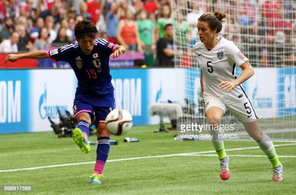 Japan's Saori Ariyoshi clears the ball under pressure from United States Kelley O'Hara during the FIFA Women's World Cup Canada 2015 Final match...