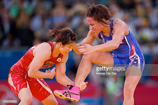 Japan's Saori Yoshida left grabbed the ankle of Kelsey Campbell of the United States right during women's 55kg freestyle wrestling action at the...