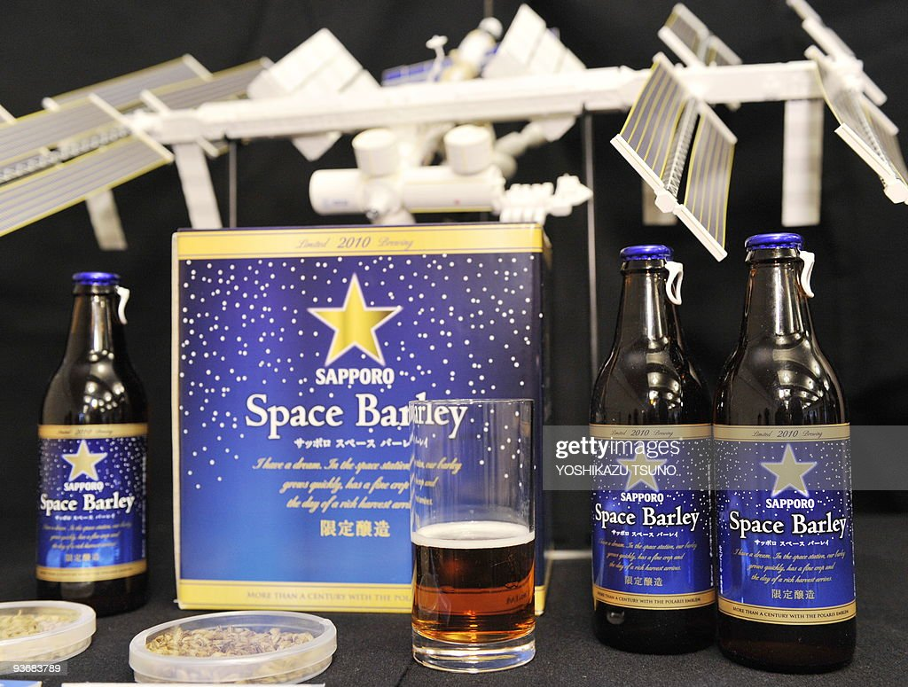 Japan's Sapporo Breweries displays bottles of 'Space Barley' beer, the world's first beer brewed from seedlings of bareleycorn that traveled to the Russian space station, during a press conference in Tokyo on December 3, 2009. Sapporo will sell 250 boxes of space beer, containing six bottles, with a price of 10,000 yen (115 USD) for a box as a charity to promote science education and the development of space science research in Japan and Russia. AFP PHOTO / Yoshikazu TSUNO