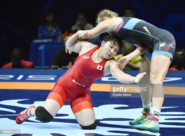 Japan's Sara Dosho and Aline Focken of Germany compete in the women's 69kilogram final at the world wrestling championships in Paris on Aug 24 2017...