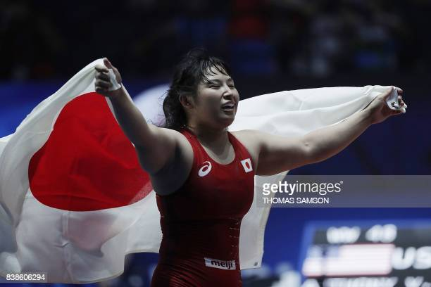 Japan's Sara Dosho celebrates after winning the women's freestyle wrestling 69kg category final at the FILA World Wrestling Championships in Paris on...