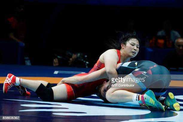 Japan's Sara Dosho competes with Germany's Aline Focken during the women's freestyle wrestling 69kg category final at the FILA World Wrestling...