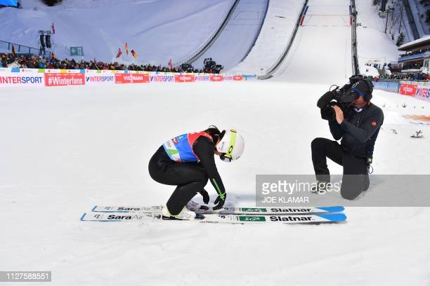 Japan's Sara Takanashi reacts after her jump during the Ladies' team ski jumping event at the FIS Nordic World Ski Championships on February 26 2019...