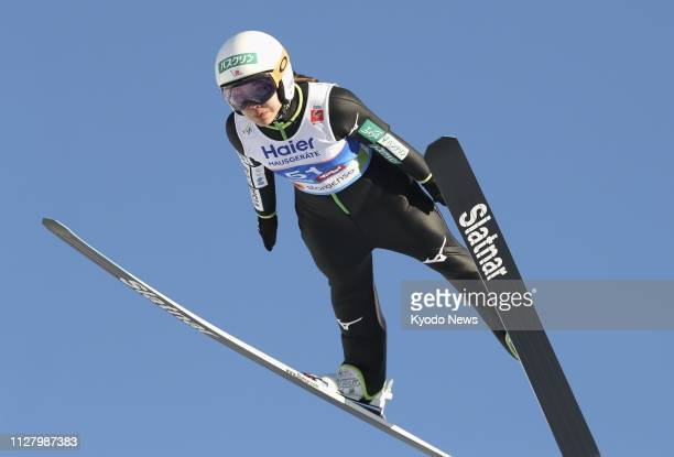 Japan's Sara Takanashi soars through the air during her first attempt at the women's individual ski jumping competition of the Nordic world ski...