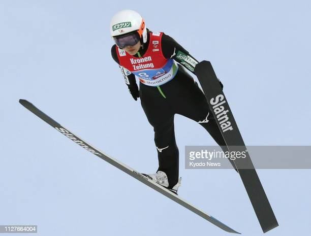 Japan's Sara Takanashi soars through the air during her first jump in the inaugural women's ski jumping team event at the Nordic world ski...