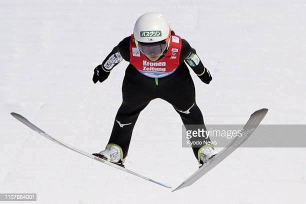 Japan's Sara Takanashi soars through the air during her second jump in the inaugural women's ski jumping team event at the Nordic world ski...