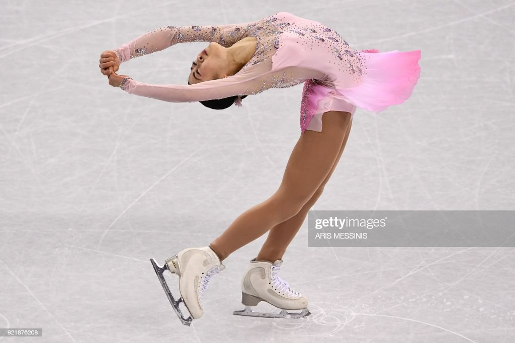TOPSHOT - Japan's Satoko Miyahara competes in the women's single skating short program of the figure skating event during the Pyeongchang 2018 Winter Olympic Games at the Gangneung Ice Arena in Gangneung on February 21, 2018. /