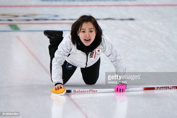 Japan's Satsuki Fujisawa shouts for instructions during the curling women's round robin session between Denmark and Japan during the Pyeongchang 2018...
