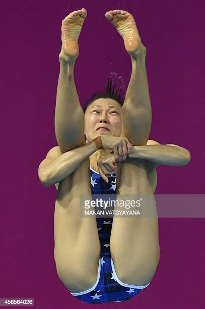 Japan's Sayaka Shibusawa competes in the final of the women's 3m springboard diving event during the 17th Asian Games at the Munhak Aquatics Center...