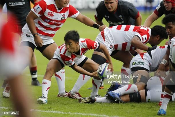 Japan's scrumhalf Shinobu Fujiwara passes the ball during the U20 World Rugby union Championship match between Wales and Japan at the Aime Giral...