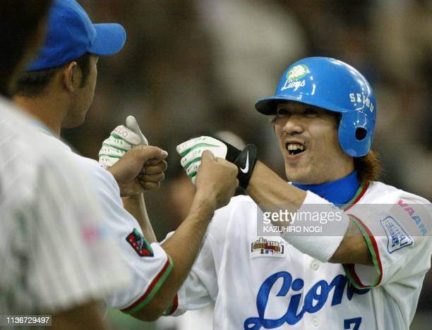 Japan's Seibu Lions infielder Kazuo Matsui celebrates his tworun homer with a teammate in the 4th inning during a game of the JapanUS AllStars...