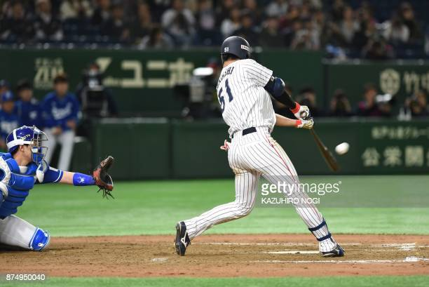 TOPSHOT Japan's Seiji Uebayashi hits a gametying homer in the tenth inning during the Asia Professional Baseball Championships preliminary round...
