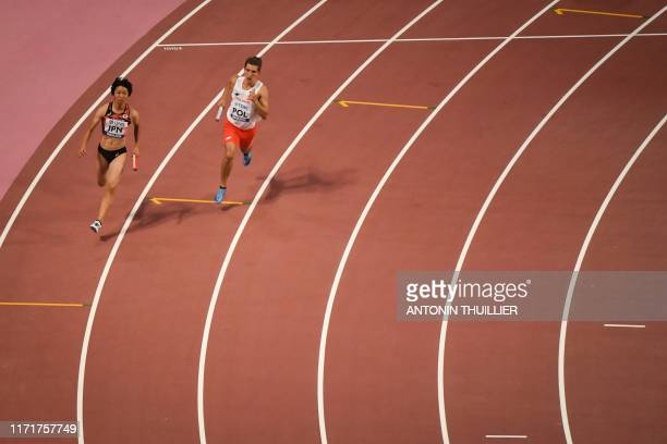 Japan's Seika Aoyama and Poland's Wiktor Suwara compete in the Mixed 4 x 400m Relay heats at the 2019 IAAF World Athletics Championships at the...