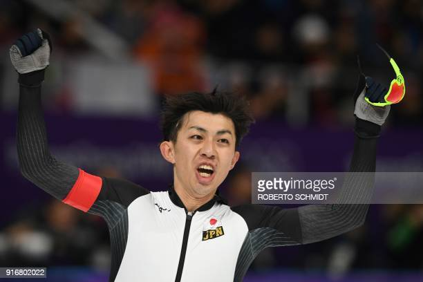 Japan's Seitaro Ichinohe celebrates his win during the men's 5,000m speed skating event during the Pyeongchang 2018 Winter Olympic Games at the...