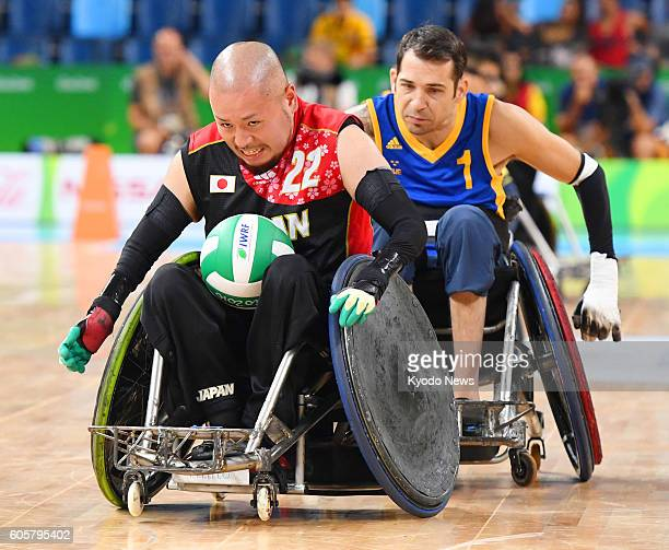 Japan's Seiya Norimatsu and Glenn Adaszak of Sweden compete during a wheelchair rugby match at the Rio de Janeiro Paralympics on Sept 14 2016 Japan...
