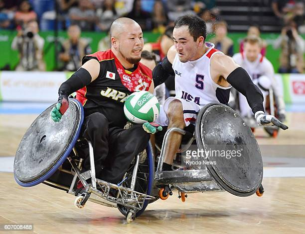 Japan's Seiya Norimatsu gets a tackle from Chuck Aoki of the United States in pool play of mixed wheelchair rugby at the Rio Paralympics on Sept 16...