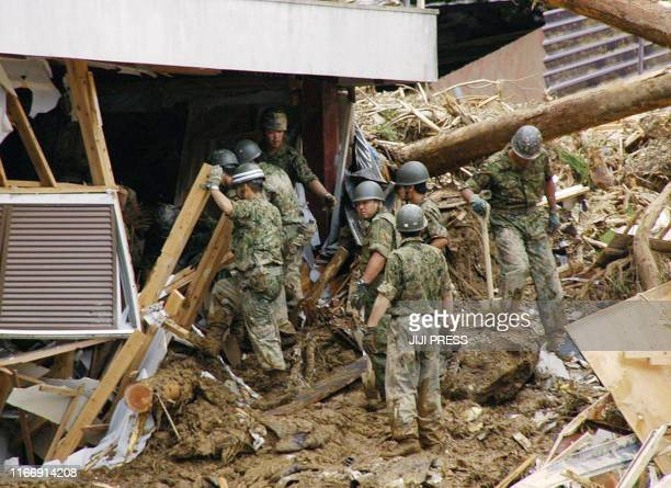 Japan's selfdefence force soldiers search for survivors after a landslide crushed a house at Siba village Miyazaki prefecture on the southern island...