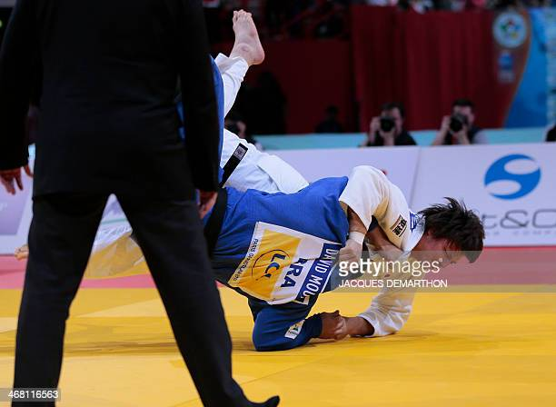 Japan's Shichinohe Ryu scores a point as he competes against Brazil's David Moura during the men's 100kg final at the 2014 Paris Judo Grand Slam...