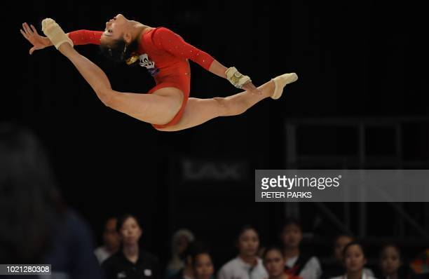 TOPSHOT Japan's Shiho Nakaji competes in the floor exercise the women's team final of the artistic gymnastics event during the 2018 Asian Games in...