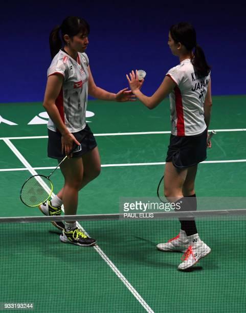 Japan's Shiho Tanaka and Koharu Yonemoto take on Japan's Yuki Fukushima and Sayaka Hirota during the womens doubles semi final of the All England...