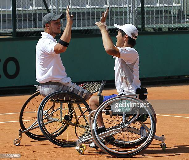 Japan's Shingo Kunieda and French Nicolas Peifer react after winning over Netherland's Robin Ammerlaan and Sweden's Stefan Olsson during their men's...