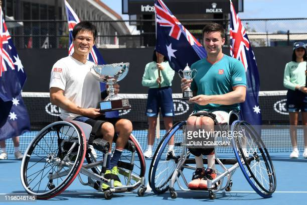 Japan's Shingo Kunieda celebrates the winning trophy as Britain's Gordon Reid poses with runnersup trophy after their men's wheelchair singles match...