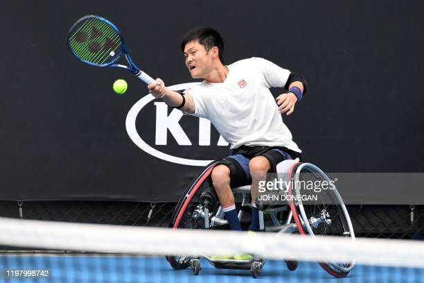 Japan's Shingo Kunieda hits a return against Britain's Gordon Reid during their men's wheelchair singles match on day fourteen of the Australian Open...