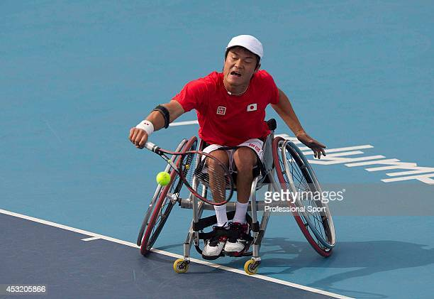 Japan's Shingo Kunieda returns against Netherlands' Ronald Vink in the semifinal of the men's singles wheelchair tennis competition at the London...
