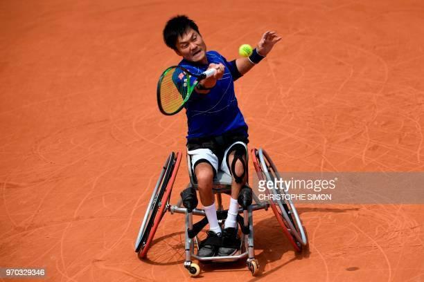 Japan's Shingo Kunieda returns the ball to Argentina's Gustavo Fernandez during their men's wheelchair singles final match on day fourteen of The...