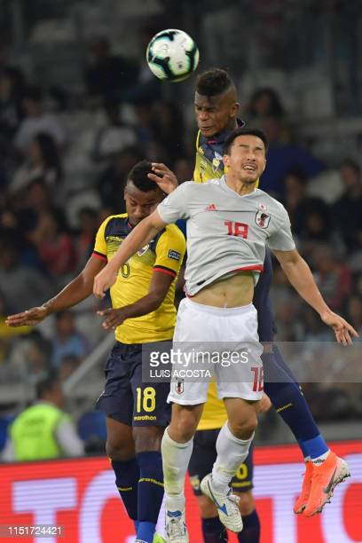 Japan's Shinji Okazaki Ecuador's Jefferson Orejuela and Ecuador's Robert Arboleda jump for a header during their Copa America football tournament...