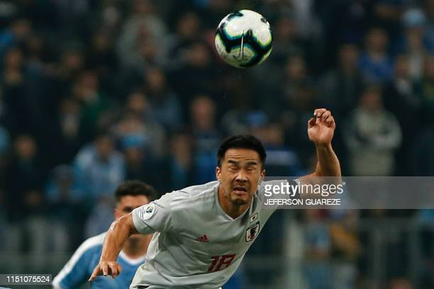Japan's Shinji Okazaki heads the ball during the Copa America football tournament Group C match between Uruguay and Japan at the Gremio Arena Stadium...