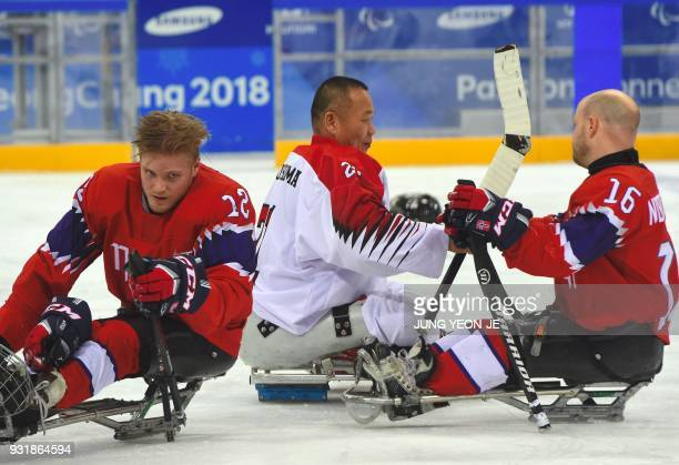 Japan's Shinobu Fukushima shakes hands with Norway players at the end of their ice hockey classification game between Norway and Japan at the...