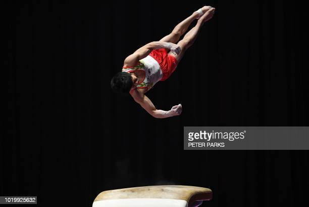 TOPSHOT Japan's Shogo Nonomura participates on the vault in the qualification one of the artistic gymnastics event during the 2018 Asian Games in...