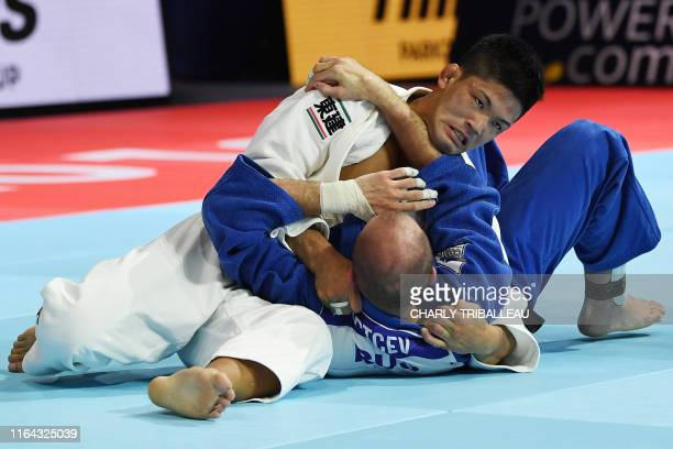 TOPSHOT Japan's Shohei Ono fights in the semifinal against Russia's Denis Iartcev in the men's under 73kg category during the 2019 Judo World...